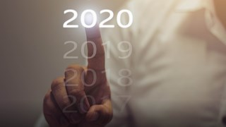 Man's finger pointing at 2020